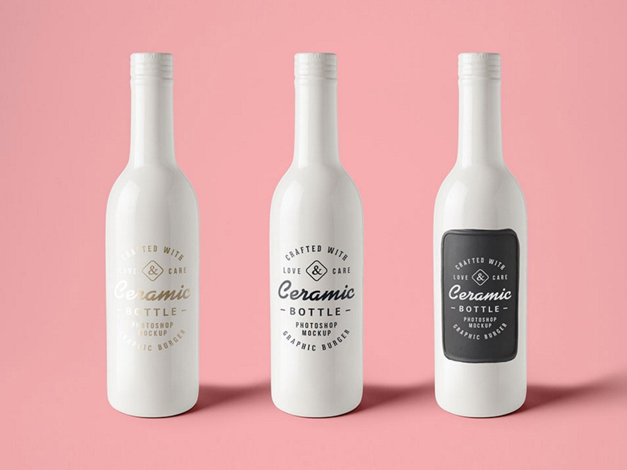 three ceramic bottles on pink background