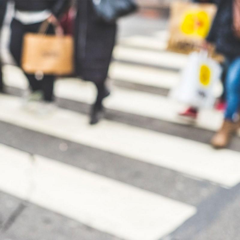 blurry people crossing the street