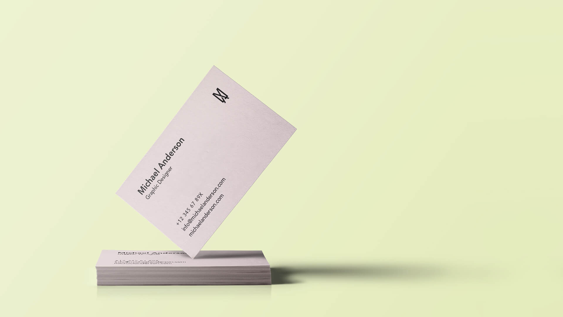 michael anderson business card mockup on yellow background