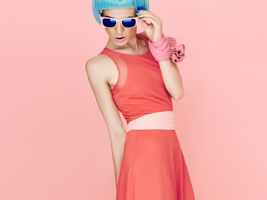blue haired model with sunglasses in a dress