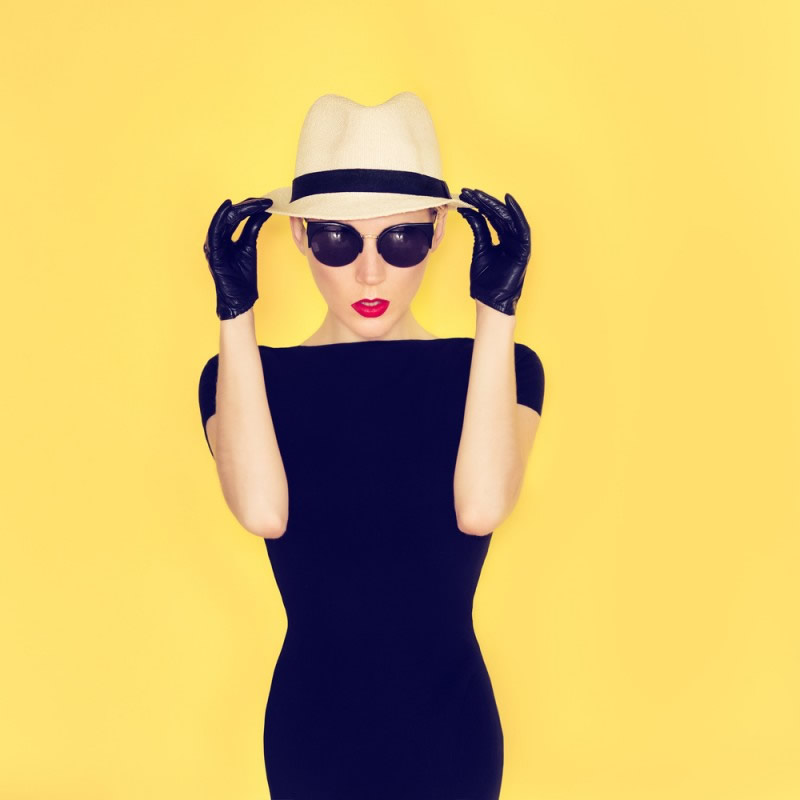 girl in the little black dress on yellow background