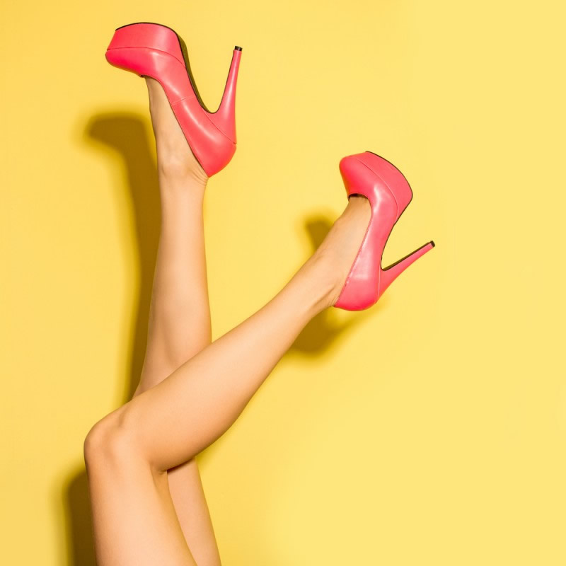 fashionista red high heels on yellow background