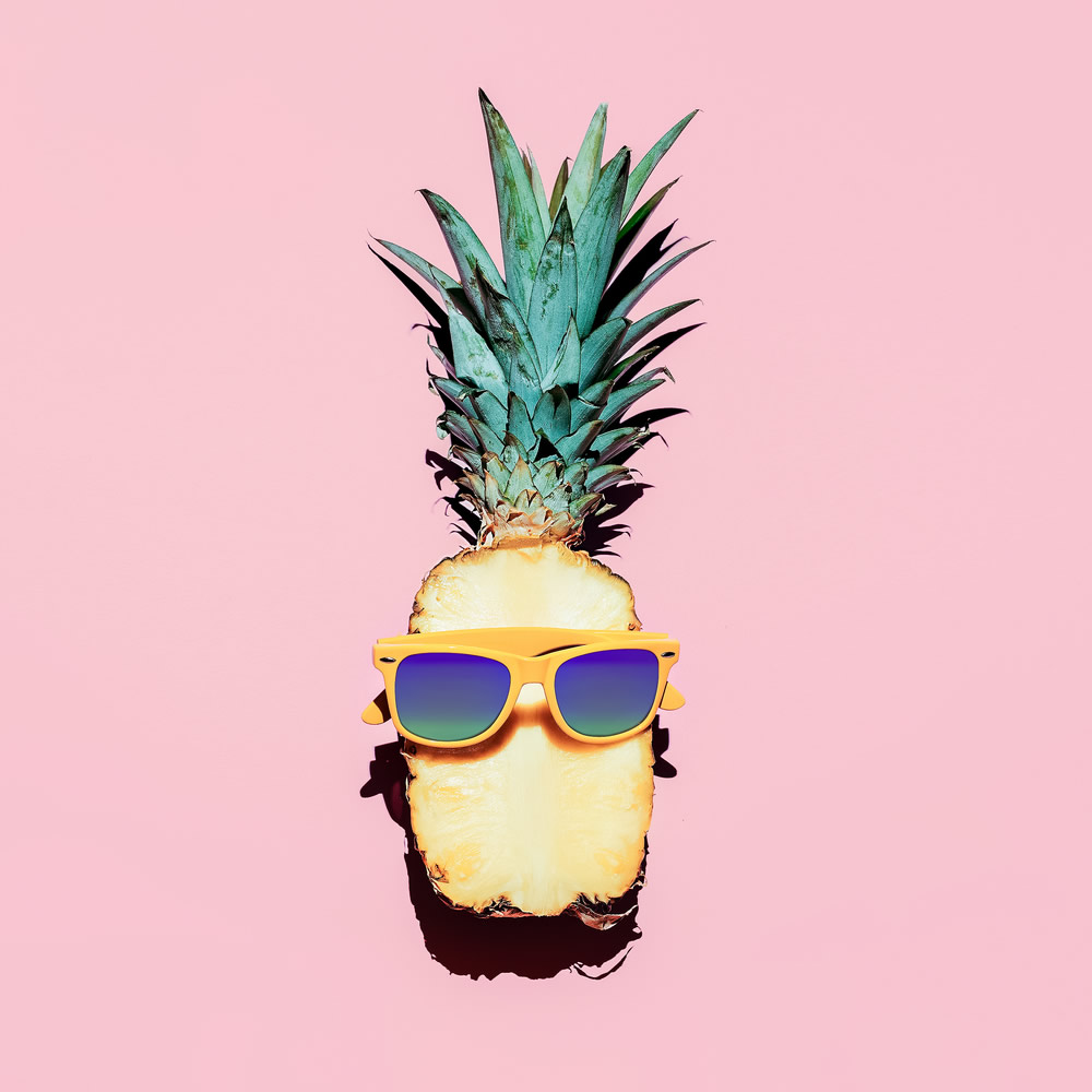 fashionable pineapple on pink background