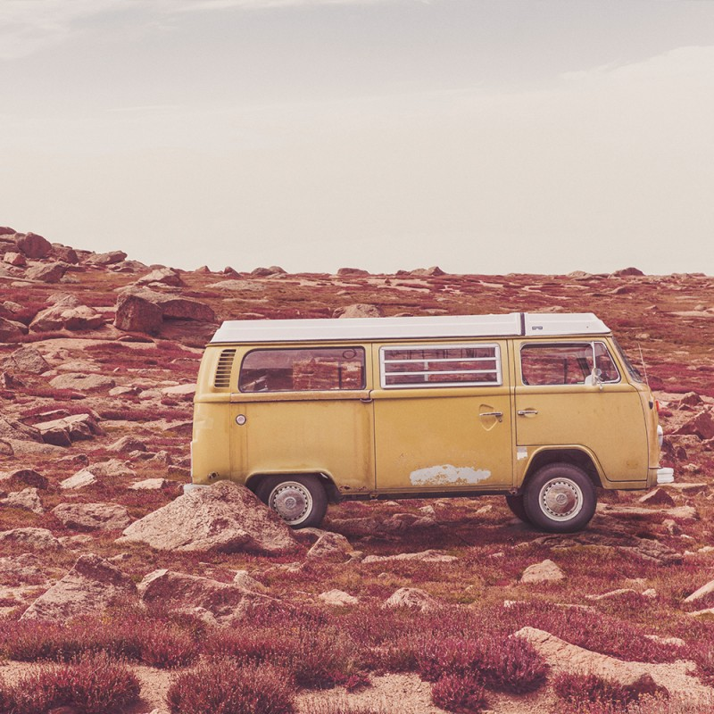 yellow van on a rocky hill