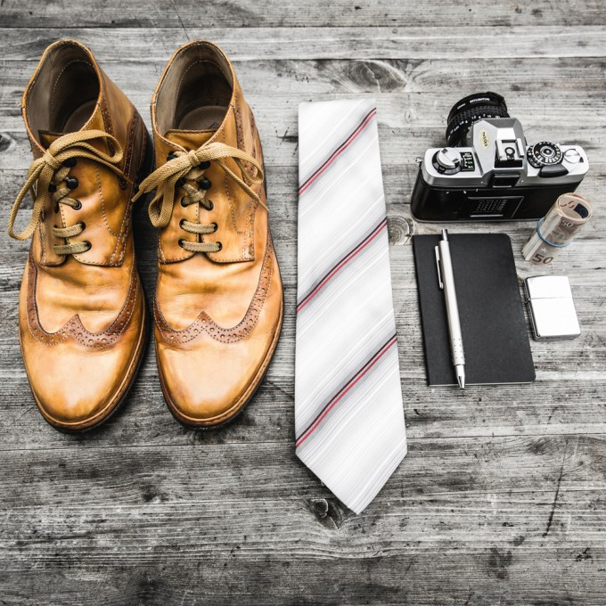 shoes tie camera notebook money lighter and pen
